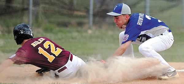Valley's Cole Huntzberry tags out Maugansville' Josh Miller at third base on Tuesday in the second inning of the Maryland District 1 Junior tournament. Maugansville came back to score a 15-12 victory to win the losers' bracket final and advance to the championship round against Conococheague.