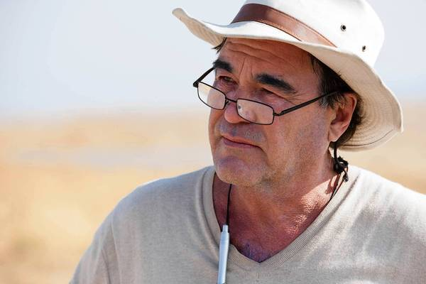 "Oliver Stone on the set of his film ""Savages."""