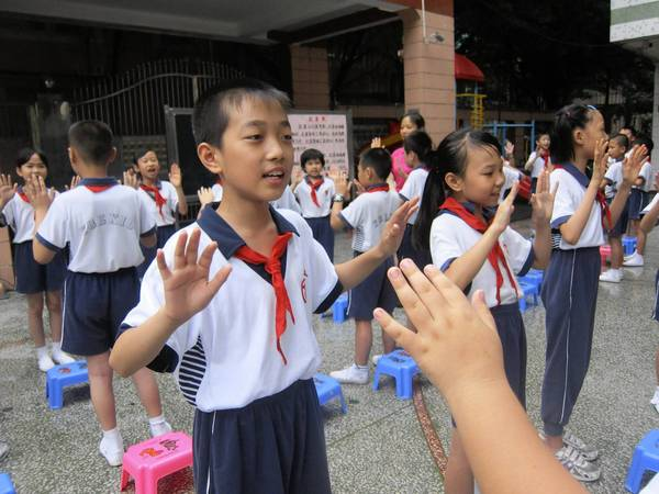 Students at Bayi Xiwang elementary and middle school in Guangzhou are given 45 minutes of outdoor instruction each day in a clinical trial aimed at fighting myopia.