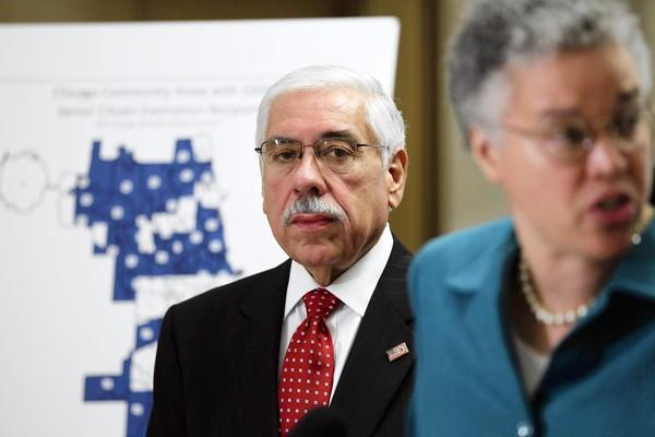 Cook County Assessor Joe Berrios, left, pictured with Board President Toni Preckwinkle, is keeping family members on the payroll — a violation of the county's ethics rules.