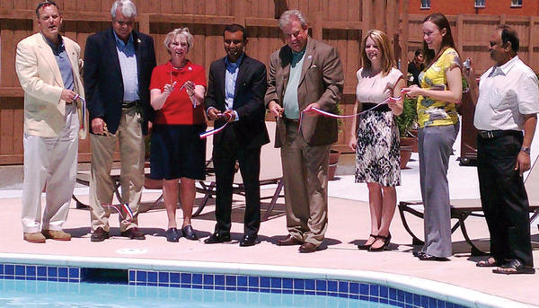 On hand June 13 to cut the ribbon on the newly constructed swimming pool, Jacuzzi and outdoor reception area at the Best Western Grand Venice Hotel are, from left, Hagerstown-Washington County Convention and Visitors Bureau President and Chief Executive Officer Tom Riford; Hagerstown City Councilman Martin Brubaker; Washington County Commissioner Ruth Anne Callaham; Grand Venice Hotel General Manager Nithin Jayadeva; Washington County Commissioner Jeff Cline; Grand Venice Hotel Director of Sales and Marketing Lauren Detwiler; Hagerstown-Washington County Chamber of Commerce Director of Member Services Jill Reddecliff; and Kemp Jayadeva.