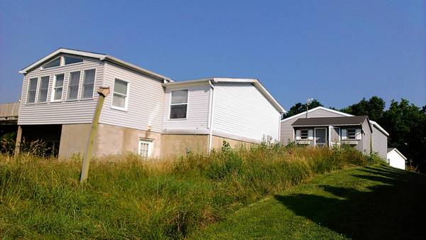 The yard at an abandoned home on Canaris Drive in Lynn Township was not cut for about a year, a neighbor says. The neighbor sought help from Lynn Township, and the grass eventually was cut in late June by PNC Bank.