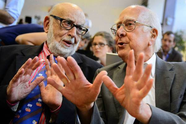 Belgian physicist Francois Englert, left, speaks with British physicist Peter Higgs at a news conference about the Higgs boson at the European Organization for Nuclear Research offices near Geneva.