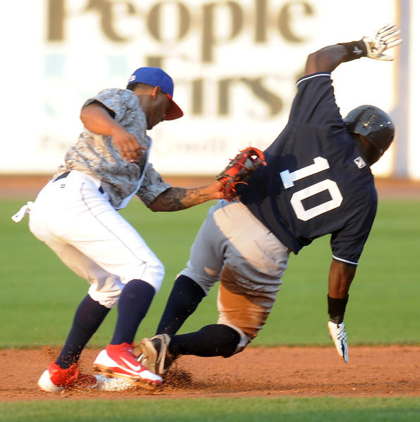 IronPigs' #2 Michael Martinez waits for the ball while Yankees' #10 Ronnier Mustelier slides into second base. Mustelier was safe. The Lehigh Valley IronPigs played the Scranton/Wilkes-Barre Yankees at Coca-Cola Park in Allentown Wednesday night.