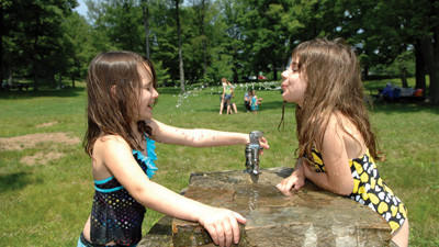 Kassidy and Kamryn McKenzie enjoy some playful fun at Laurel Hill State Park Wednesday.