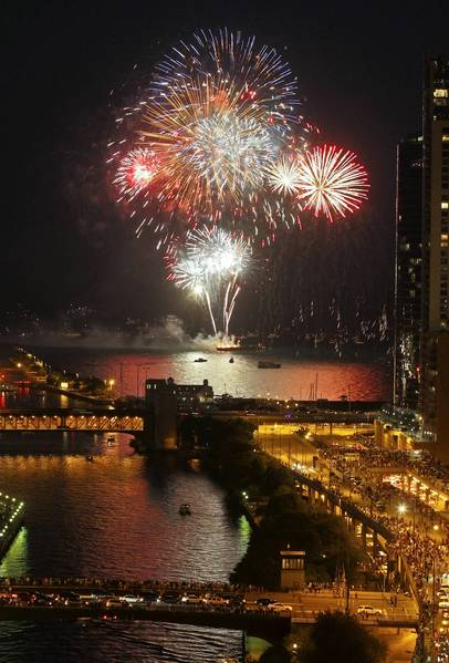 Fireworks, as viewed from Trump Tower, explode over Lake Michigan as part of the display at Navy Pier.