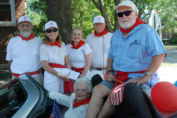Members of the Ernest Hemingway Foundation in the shade before the Oak Park July 4 parade.