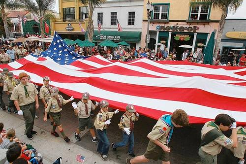 Huntington Beach Boy Scouts carry the city's historic Freedom Flag down Main Street during the Huntington Beach 4th of July Parade.