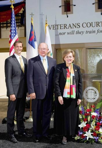 TRIBUTE: Brent Theobald, Adm. Vernon E. Clark and Carol Taylor, president of Vanguard University, at the dedication of Vanguard's Courtyard of Honor for U.S. veterans.