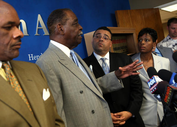 Cook County Commissioner William Beavers, surrounded by attorneys Victor Henderson, left, Sam Adam Jr. and Vivian Tarver-Varnado tells reporters he has bank records that will refute a central charge against him - that he didn't pay taxes on $68,000 that he took from his campaign.