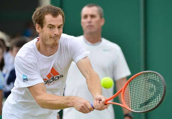 Andy Murray of Britain trains with his coach, Ivan Lendl, at the Wimbledon tennis championships in London.