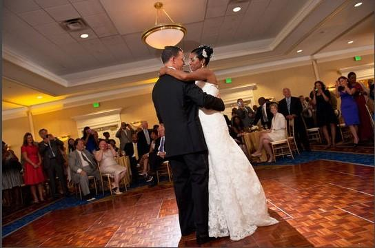 Lt. Gov. Anthony Brown and Karmen Walker share the first dance at their wedding reception. The reception was attended by some of Maryland's political heavyweights. Among those in the background, left: U.S. Sen. Ben Cardin and U.S. Rep. Steny Hoyer, the House minority whip.