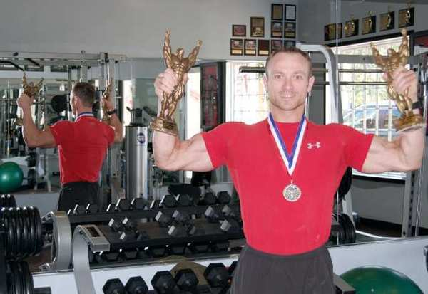 Adrian Pietrariu, owner of West Coast Boot Camp in La Canada Flintridge, took home four trophies at an International Natural Bodybuilding Assn. competition June 30.
