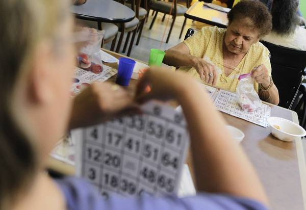 Anna Vitko, right, finishes up playing bingo at the La Grange Park, IL, skilled care facility called The Grove on Wednesday, November 23, 2011. Bingo, like other activities at the facility, is intended to stimulate the brains of residents and also strengthen their eye-hand coordination.