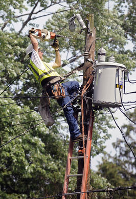 A storm response team member of Florida's PDA works on an electrical pole at the 700 block of Hollen Road to restore electrical power to the area, which has lost power for almost a week since last Friday's storm.