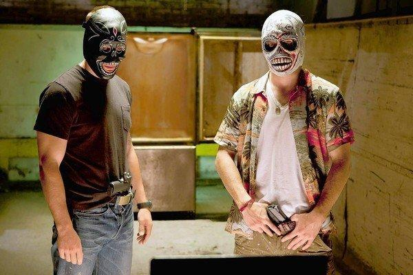 "Taylor Kitsch, left, and Aaron Johson star in Oliver Stone's ""Savages."""