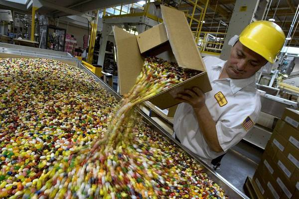 A coalition aimed at ending the U.S. sugar program says it costs consumers as much as $3.5 billion a year in higher food prices. Above, Francisco Tril empties out jelly beans for packaging at the Jelly Belly factory in Fairfield, Calif.