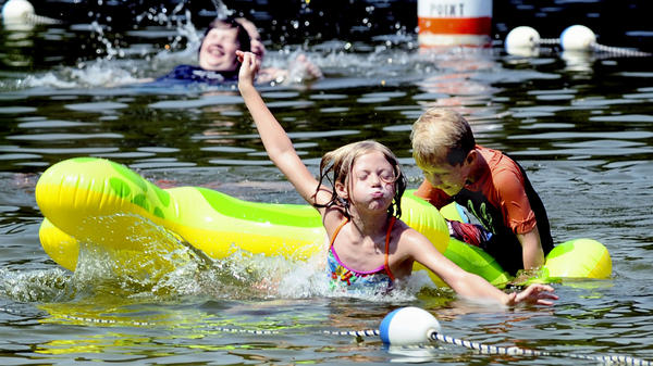Emma, left, and Luke Fair enjoy the cool water of the lake at Greenbrier State Park in Washington County on Thursday. The high temperature in Hagerstown on Thursday was 96 degrees, and temperatures in the 90s are forecast for through Sunday.