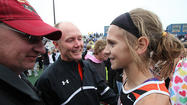 Ipswich track and field coach Todd Thorson and Ipswich athlete Macy Heinz added another honor to their collections.