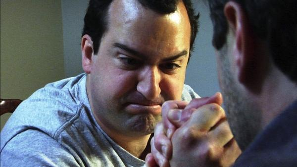"Mark (Steve Zissis) competes in arm wrestling, just one event in ""The Do-Deca Pentathlon,"" written and directed by Jay and Mark Duplass."