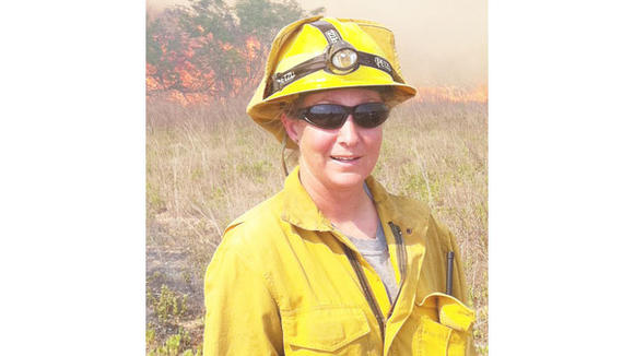 Dana Pelton, a fire officer with the Michigan Department of Natural Resources, helped battle the wildfires which raged across Texas in 2011.