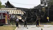 Two killed in train derailment and bridge collapse