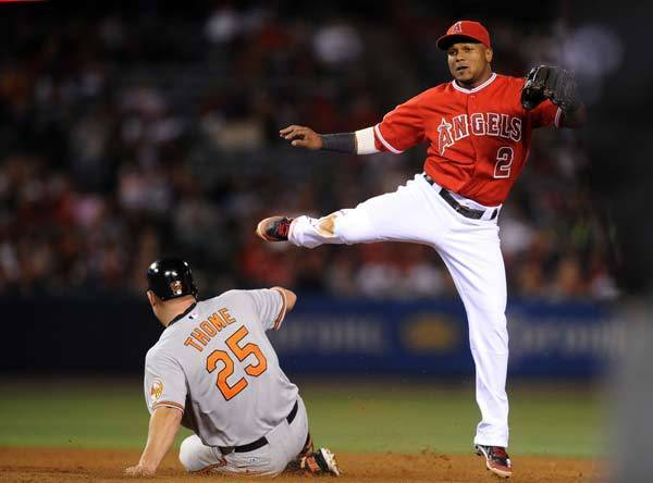 Los Angeles Angels short stop Erick Aybar (2) attempts a throw after forcing out Baltimore Orioles designated hitter Jim Thome (25) during the fifth inning at Angel Stadium of Anaheim.