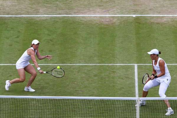Liezel Huber (R) and Lisa Raymond in action during their Ladies¿ Doubles semi final match against Serena and Venus Williams on day eleven of the Wimbledon Lawn Tennis Championships at the All England Lawn Tennis and Croquet Club.