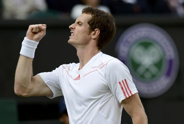 Andy Murray of Britain reacts to breaking the serve of Jo-Wilfried Tsonga of France in the fourth set during their men's semi-final tennis match at the Wimbledon tennis championships in London.