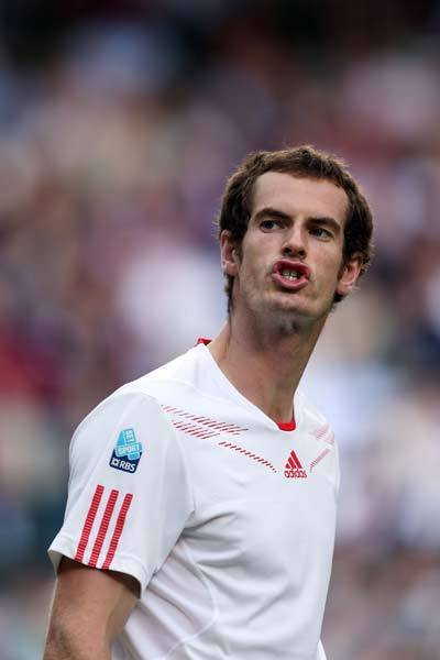 Andy Murray of Great Britain reacts during his Gentlemen's Singles semi final match against Jo-Wilfried Tsonga of France on day eleven of the Wimbledon Lawn Tennis Championships at the All England Lawn Tennis and Croquet Club.