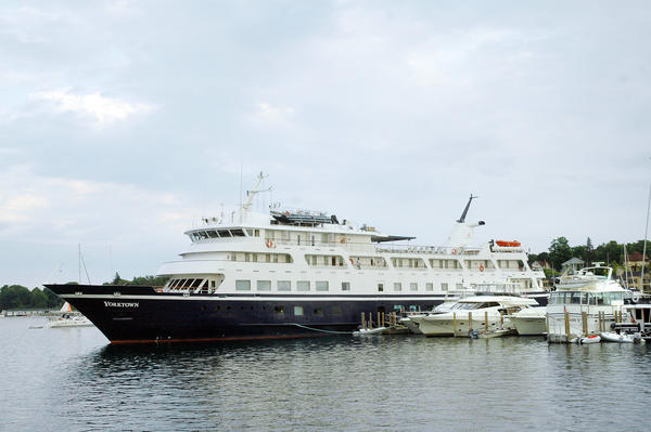The vessel Yorktown is shown docked at the end of the Charlevoix Municipal Marina's A Dock while passengers enjoy a meal in its dining room Wednesday evening.