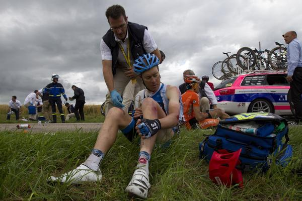 American Tom Danielson receives medical assistance after the crash of around 30 riders 26 km before the end of the 207,5 km and sixth stage of the 2012 Tour de France cycling race starting in Epernay and finishing in Metz, northeastern France, on July 6, 2012.