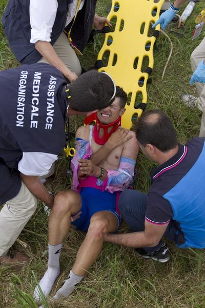 Italy's Davide Vigano reacts on a stretcher after the crash of around 30 riders 26 km before the end of the 207,5 km and sixth stage of the 2012 Tour de France cycling race starting in Epernay and finishing in Metz, northeastern France, on July 6, 2012. Vigano retired from the race.