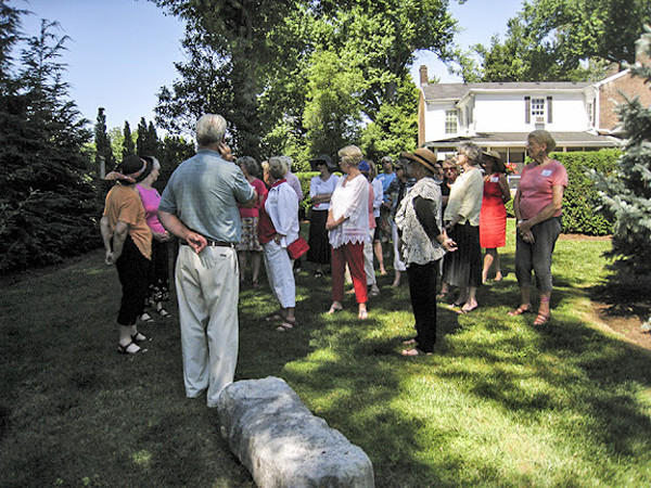 The Danville Garden Club was invited to the Maple Avenue home of John and Mary Jo Bowling, Twin Hollies, for its annual club picnic. The property includes their 1833 home and two smaller buildings on three acres