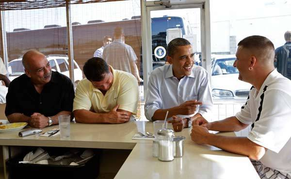 President Obama talks to Keith Ross as he sits down for breakfast at Ann's Place restaurant in Akron, Ohio