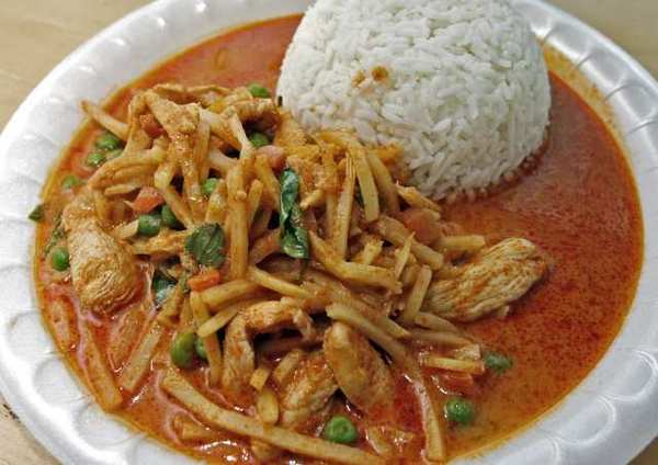 Red curry chicken with bamboo shoots, basil, peas, carrots and rice, from 40 Love Cafe at the Burbank Tennis Center in Burbank.