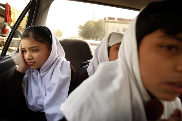 Obaida Rahmati makes the trip to school from the Kabul shelter where she lives. When she was 9, her heroin-addicted father sold her to a neighbor, who planned to marry her as soon as she turned 12, a fate she narrowly escaped. (Rick Loomis / Los Angeles Times)