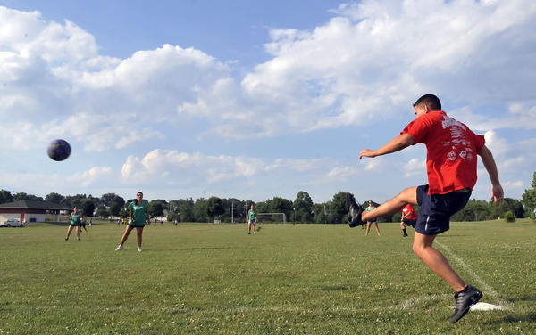 Trevor Richardson of Hagerstown kicks the ball at a recent game of the adult kickball league at Fairgrounds Park.