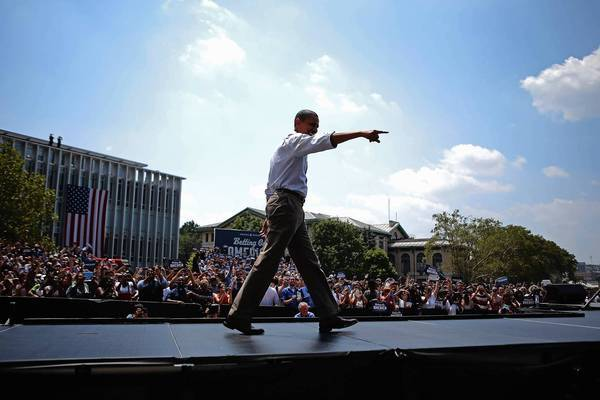 President Obama greets the crowd before a campaign speech at Carnegie Mellon University in Pittsburgh during his two-day bus trip through Ohio and Pennsylvania.