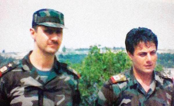 An undated photo taken in Syria shows Brig. Gen. Manaf Tlas, right, with President Bashar Assad.