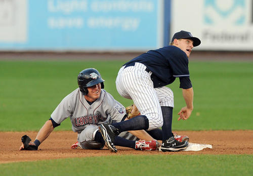 Lehigh Valley IronPigs' Pete Orr (2) left, gets tagged out by Scranton / Wilkes-Barre Yankees' Joseph Corban (1) right, after over sliding second base during their game at Coca-Cola Park in Allentown Friday night.