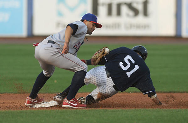 Scranton / Wilkes-Barre Yankees' Ray Kruml (51) right, slides safely under the tag from Lehigh Valley IronPigs' infielder Andres Blanco (5) left, during their game at Coca-Cola Park in Allentown Friday night.