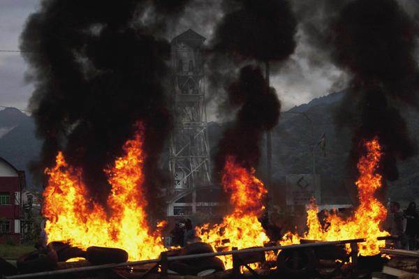 A barricade built by coal miners burns during clashes with the Spanish riot civil guard at the Pozo Santiago coal mine in Aller, in northern Spain, July 6, 2012. The coal miners are protesting against the government's proposal to decrease funding for coal production.