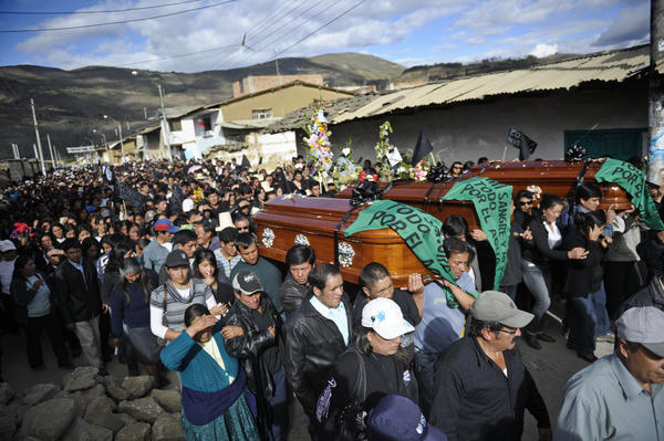 People march behind the coffins of three demonstrators who died during the protests against the Conga mining project, in Celendin, Cajamarca, Peru, on July 6, 2012. The death toll from clashes between security forces and demonstrators fighting a planned $4.8 billion gold mine by US-based Newmont in northern Peru has climbed to five, medical officials said Thursday.