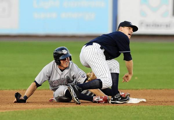 Lehigh Valley IronPigs' Pete Orr (2) ,left, gets tagged out by Scranton / Wilkes-Barre Yankees' Joseph Corban (1), right, after over- sliding second base during their game at Coca-Cola Park in Allentown Friday night.