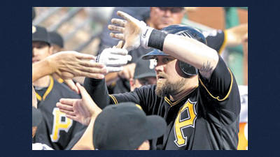 Pittsburgh Pirates' Casey McGhee, right, celebrates with teammates after hitting a solo home run off San Francisco Giants pitcher Barry Zito during the fifth inning of a baseball game against the San Francisco Giants during a baseball game in Pittsburgh, Friday.