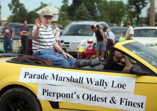 Wally Loe, parade Marshall, waves to the crowd during the Pierpont 125th Anniversary parade. photo by john davis taken 7/7/2012