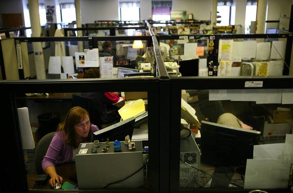 Child welfare specialist Kim Abner works on a case at the DCFS hotline call center in Springfield last month.