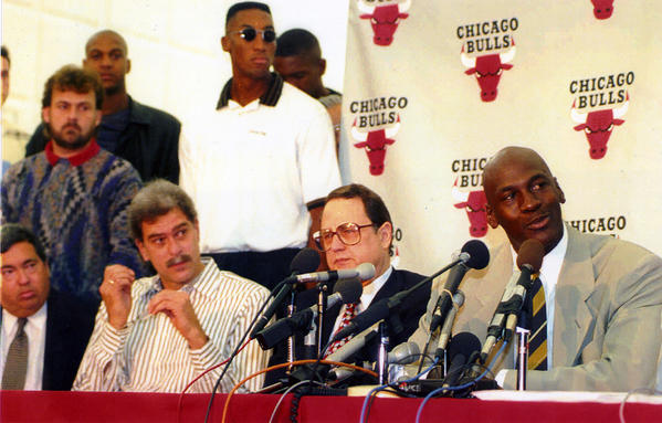 Bulls star Michael Jordan (right) announces his retirement at the Berto Center in Deerfield on October 6, 1993. Seated from left: Bulls GM Jerry Krause, Bulls coach Phil Jackson, Bulls owner Jerry Reinsdorf and Jordan. Bulls forward Scottie Pippen is in the rear, wearing sunglasses.