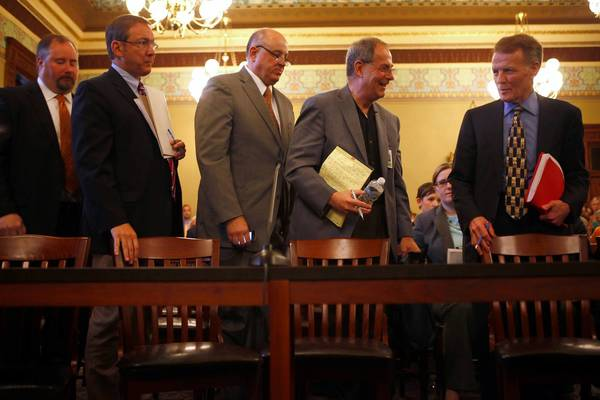 House Speaker Michael Madigan, right, greets labor officials and other opponents of the state pension reform plan that Madigan had just presented in May to the House Personnel and Pensions Committee.